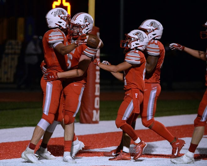 Freedom's Reiker Welling celebrates with his teammates after scoring a touchdown in the 2nd quarter against Neshannock.