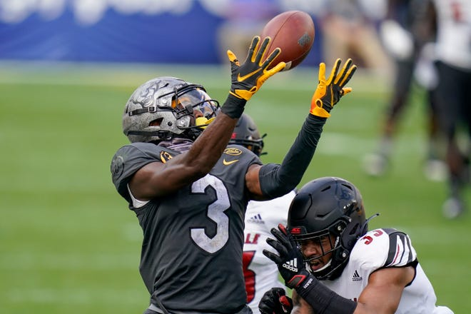 Louisville defensive back Isaiah Hayes (33) breaks up a pass to Pittsburgh wide receiver Jordan Addison (3) during the second half. (AP Photo/Keith Srakocic)