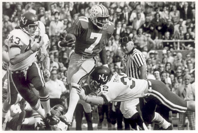 Cornelius Green, here running in a 1973 game against Northwestern, was Ohio State's first Black quarterback. [Dispatch file photo]