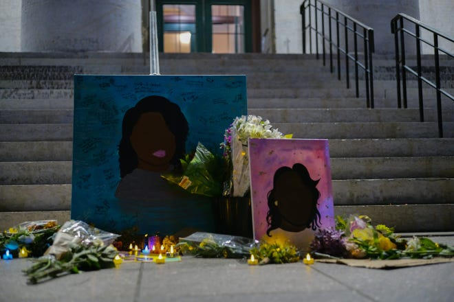 A memorial for Breonna Taylor sits outside the Ohio Statehouse on Sept. 25 following a vigil in Columbus, Ohio. Taylor, a 26-year-old Black woman, was killed while sleeping in her home by Louisville Metro police officers in March. The Kentucky attorney general recently released the findings of a grand jury, who charged just one of the three officers involved, Brett Hankison, with wanton endangerment for shots fired through Taylor's walls and into the neighboring apartment. No charges relating to Taylor's death were filed.
