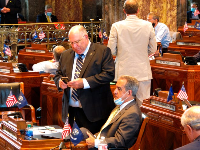 Sen. Mike Fesi, R-Houma, standing, speaks with Sen. Louie Bernard, R-Natchitoches, on the Senate floor in the final hours of Louisiana's special legislative session on June 30 in Baton Rouge.