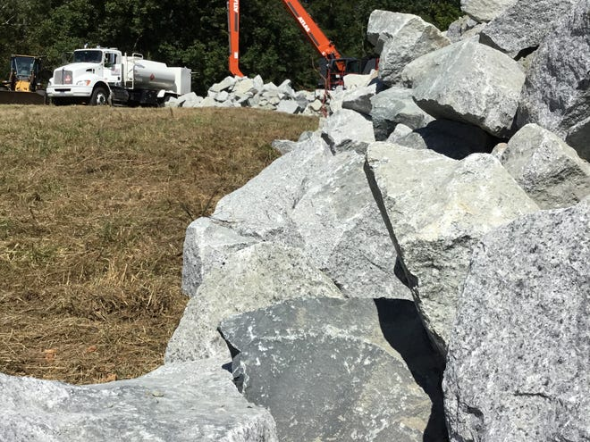 A large grappler is finishing moving a stone prior to being refueled on the Watani grassland at the North Carolina Zoo on Tuesday, Sept. 22, 2020, in Asheboro, N.C. It was just one piece of equipment donated to use in construction of a rock wall in front of the habitat's lake