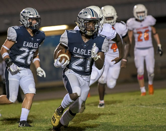 South Lake's Brandon Gibson (21) runs for a touchdown during Friday's game against Leesburg at South Lake High School in Groveland. [PAUL RYAN / CORRESPONDENT]