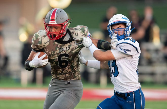 Norwayne's Ameer Cunningham tries to get away from Chippewa's Jake Fisher during the Bobcats' 62-7 win. He succeed most of the night,  putting up 150 combined rushing and receiving yards on 12 touches for two TDs.