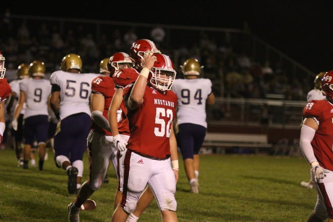 DCG senior Blake Willey pumps up the crowd on Friday, Sept. 25 in the homecoming battle with Norwalk.
