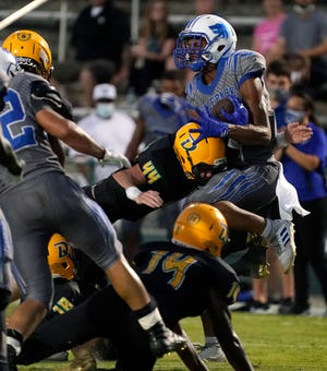Robert Uccello (44) and DeLand's defense blanked Deltona as the Bulldogs opened their season with a 39-0 victory over the Wolves on Friday night.