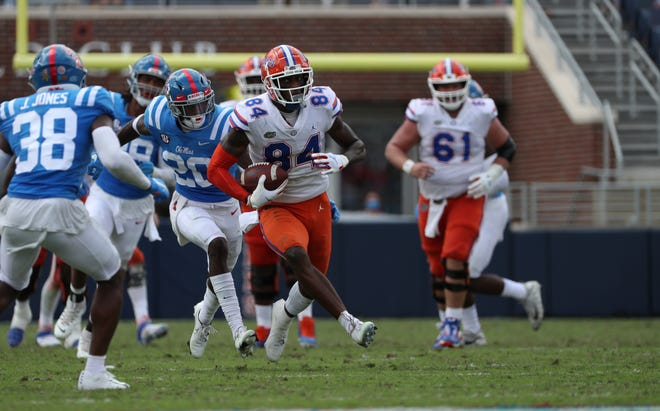 Kyle Pitts takes off for one of his four touchdowns during the Gators' win Saturday over Ole Miss at Vaught-Hemingway Stadium in Oxford, Miss.