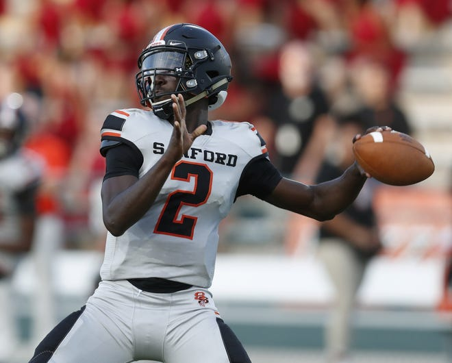 Seminole quarterback Timmy McClain (2) threw for 137 yards and rushed for two touchdowns in a 31-14 win over visiting Mainland on Friday night.