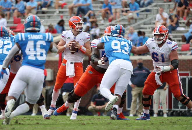 Florida quarterback Kyle Trask looks down field on a pass play during a four-touchdown first half against the Rebels Saturday at Vaught-Hemingway Stadium in Oxford, Miss.