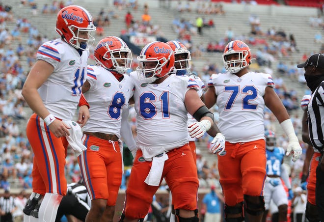 Kyle Trask (11), Trevon Grimes (8), Brett Heggie (61) and Stone Forsythe (72) in Florida's game against Ole Miss last Saturday at Vaught-Hemingway Stadium in Oxford, Miss.