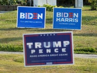 Biden/Harris and Trump/Pence signs, placed in neighboring yards, are shown on Sept. 23, 2020, in Lawrence Park Township.