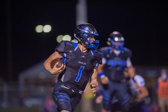 Grain Valley quarterback Cole Keller finds open space on a keeper in last Friday's game against Kearney. Keller's father John played at Grain Valley with Fort Osage coach Brock Bult. The Eagles meet Bult's Indians Friday/