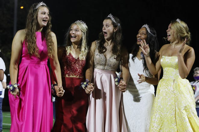 Burlington High School's Jessica Kendell, left, reacts after being named 2020 homecoming queen along with her fellow queen candidates Adessa Brandenburg, Brynn Casady, Madison Bunton and Elayna Zaiser, Friday, Sept. 25, during the halftime of their homecoming game against Fort Madison High School at Burlington's Bracewell Stadium. Michael Alexander was named the homecoming king.