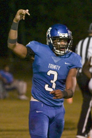 Trinity Christian running back Treyaun Webb celebrates after scoring a touchdown against Columbia in September.