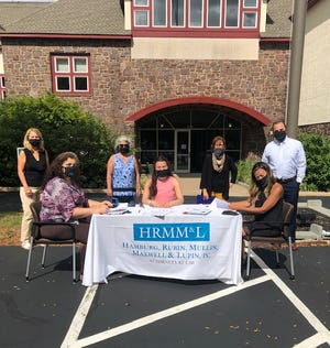 Staff members from Hamburg, Rubin, Mullin, Maxwell and Lupin law firm, located in Lansdale, hosted a client drive-thru legal document signing event in the building's parking lot.