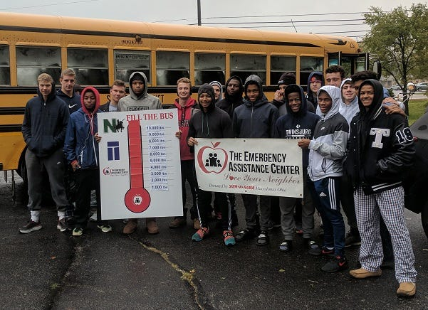 """Nordonia Hills and Twinsburg students are joining in again to """"Fill the Bus"""" for The Emergency Assistance Center. Pictured are some of the volunteers who helped with the 2018 food drive."""