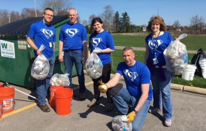 Employees with Safran USA's Twinsburg plant helping out with a cleanup at Liberty Park in 2018. The manufacturer of electric power components for the airline industry is getting a grant from the city to help it retain jobs in town.