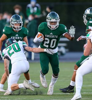 Nordonia running back Shane Robinson runs through the hole during the Knights' game with Highland Sept. 18. Robinson ran for 111 yards and two touchdowns on just two carries in Nordonia's 62-14 home win over North Royalton Sept. 25.