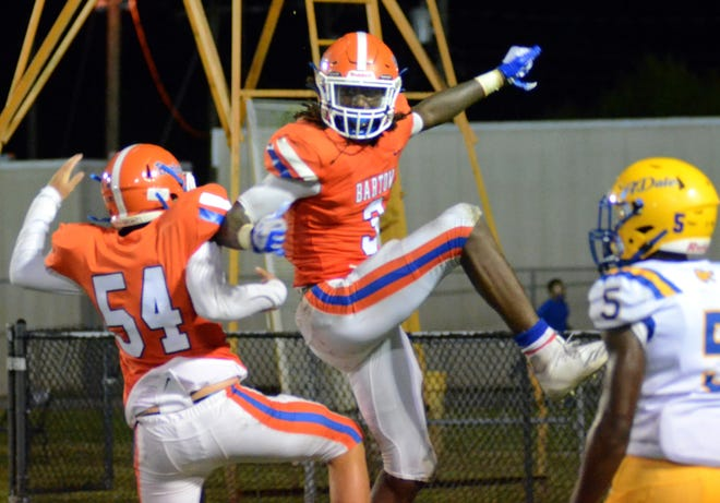 Bartow senior wide out Daithan Davis air bumps with No. 54 after hauling in a 25-yard touchdown catch with 6 seconds remaining in the first half to give the Yellow Jackets at 13-0 halftime lead over Auburndale. Davis caught two touchdown passes on the night.