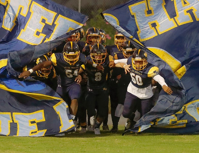 Winter Haven runs on the field before the high school football game against Ridge Community at Denison Stadium in Winter Haven, Florida  September 25, 2020.