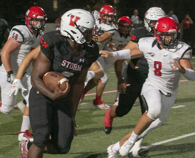 Victory Christian running back Cornelius Shaw picks up some of his 354 yards on the ground against Cardinal Mooney on Friday night at Victory Field in Lakeland.