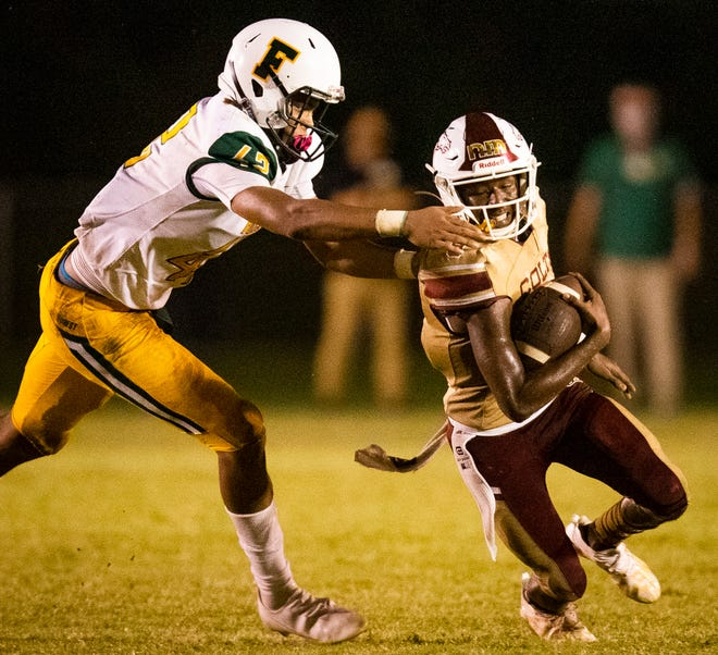 Forest's (42) Elijah Russell sacks North Marion's (9) Quintin Gross in the second half. The Forest Wildcats defeated the North Marion Colts 7-0 on opening night of high school football for area public schools Friday night September 25, 2020 at Stan Toole Stadium. [Doug Engle/Ocala Star Banner]2020