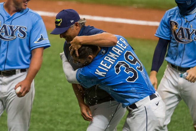Rays manager Kevin Cash hugs center fielder Kevin Kiermaier after he hit a walkoff triple in the 10th inning to beat the Blue Jays at Tropicana Field in July.