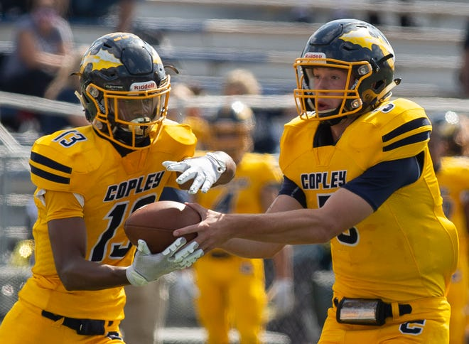 Copley quarterback Joe Reho hands the football off to running back Preston Taylor in a game earlier this season against Kent Roosevelt. Reho and Taylor helped Copley win that game over Kent and they contributed to a win over Revere on Friday night