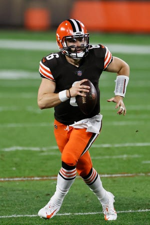 Cleveland Browns quarterback Baker Mayfield looks to throw during the first halfagainst the Cincinnati Bengals on Sept. 17 in Cleveland. The Browns play at the Dallas Cowboys on Sunday. (AP Photo/Ron Schwane)