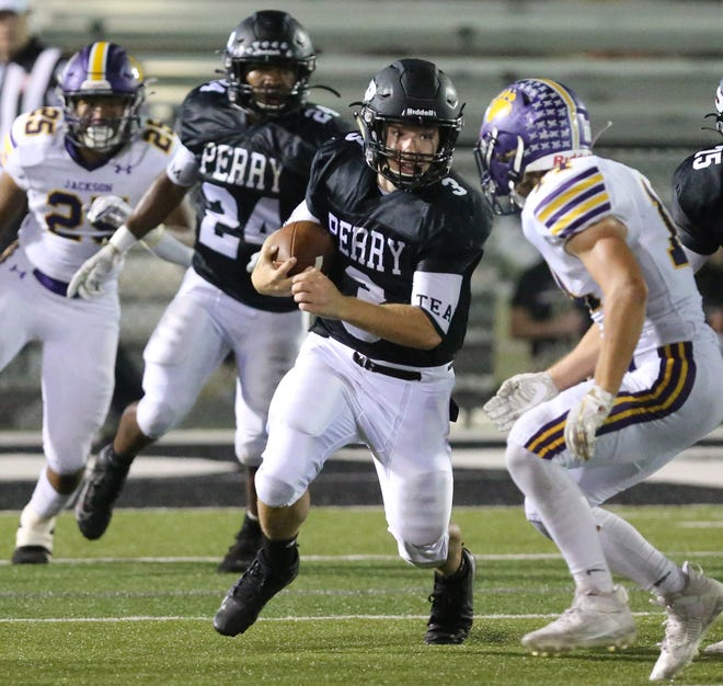 Perry QB Hayden Vinas (3) picks up yardage during their game against Jackson at Perry on Friday, Sept. 25, 2020. In the background for the Panthers is Joshua Lemon (24).