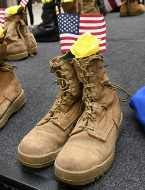 """The Stark County Veterans Service Commission held a """"Silent Watch"""" in Belden Village Mall in order to draw attention to suicides among U.S. military veterans, Sept. 26, 2020.  The display contained 22 pairs of boots, which signifies the number of veterans lost to suicide each day."""