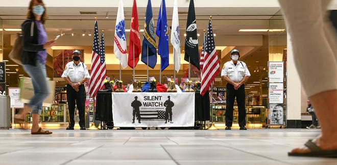"The Stark County Veterans Service Commission held a ""Silent Watch"" in Belden Village Mall on Saturday to draw attention to suicides among U.S. military veterans. The display contained 22 pairs of boots, which signifies the number of veterans lost to suicide each day."