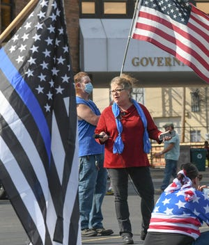 Deborah Bartlett, founder of Stark County Back the Blue and The Original Stark County Crime Watchers group on Facebook, welcomes people Saturday as they gathered for a Back the Blue rally in the parking lot of the Massillon Government & Justice Center.