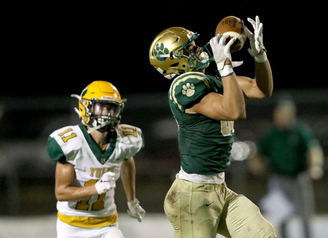 Nease wide receiver Grant Stevens(88) makes a catch against Yulee linebacker Landon Hale (11) in the second quarter.