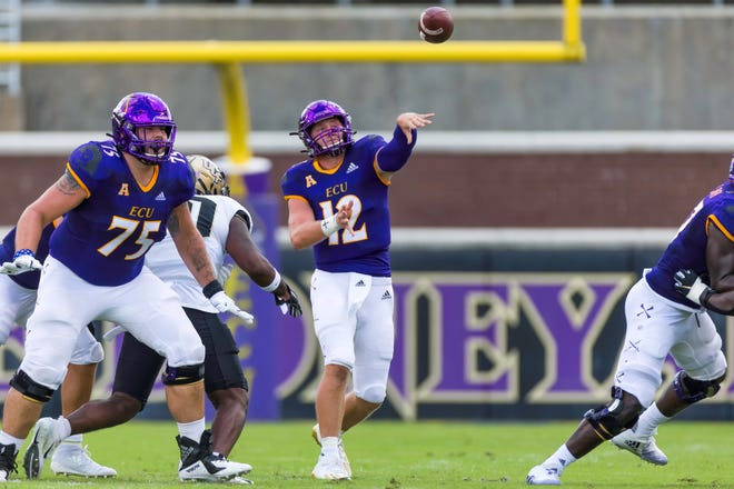ECU's Holton Ahlers makes a pass in season opener against USF. Ahlers helped lead the Pirates to their first victory of the season over USF Saturday in Tampa. [Rob Goldberg, ECU Athletics]