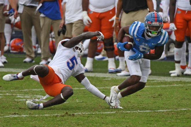 Mississippi wide receiver Elijah Moore runs past Florida linebacker David Reese (4) during the second half Saturday in Oxford, Miss. No.6 Florida won 51-35.