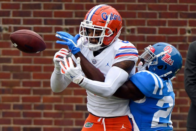 Mississippi defensive back A.J. Finley (21) breaks up a pass intended for Florida wide receiver Trevon Grimes (8) during the first half Saturday in Oxford, Miss.