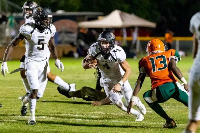 Buchholz quarterback Creed Whittemore rushes for a first down against Eastside at Citizen's Field in Gainesville on Friday. The Bobcats defeated the Rams 54-0.