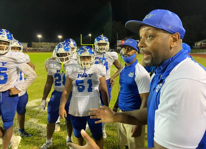 P.K. Yonge head coach Marcus McDonald shouts instructions during a fourth-quarter timeout Friday night at Santa Fe High.