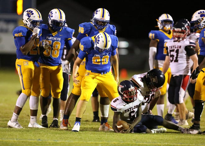 The Newberry Panthers defense looms over Taylor running back Ja'veon Harris (6) after a big tackle during a football game in Newberry. The Panthers beat the Bobcats 37-14.
