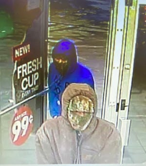 Lexington police are searching for two suspected accused of armed robbery.