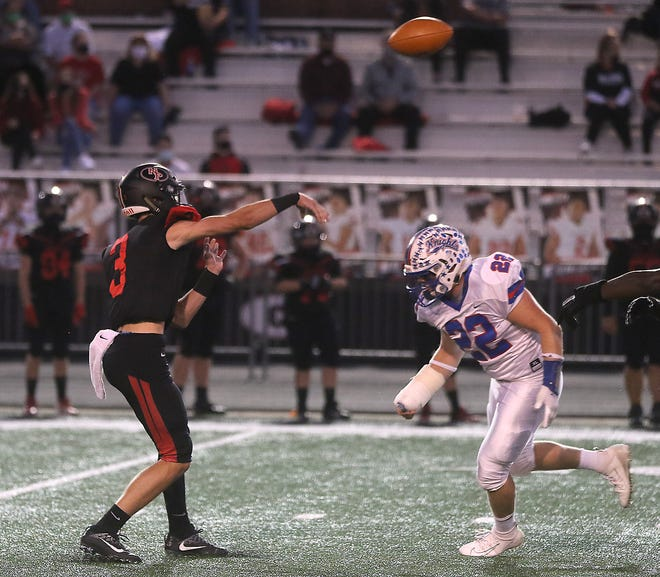 New Philadelphia's quarterback Caden O'Neill throws a pass in the game with West Holmes Friday. (TimesReporter.com / Jim Cummings)