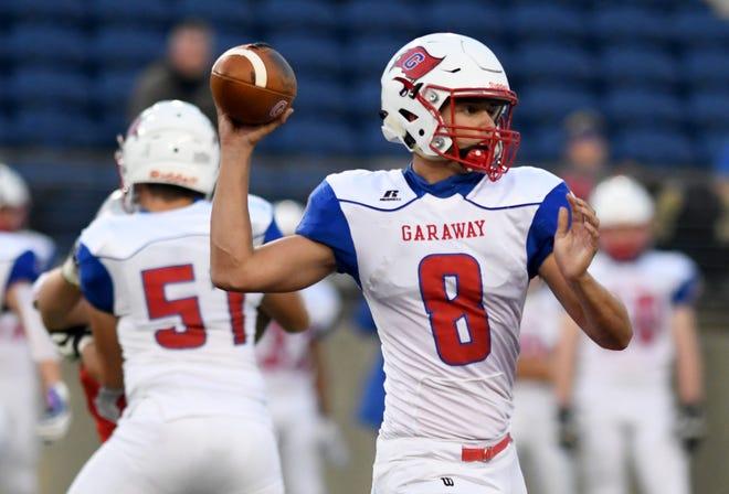 Garaway quarterback Garrett Newsome sets to pass against Sandy Valley Friday night.