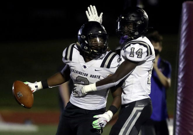 Pickerington North's Dawaun Green (3) and Carl Allen II (14) celebrate Green's 10-yard touchdown run against host New Albany on Sept. 25. The Panthers defeated the Eagles 56-21.