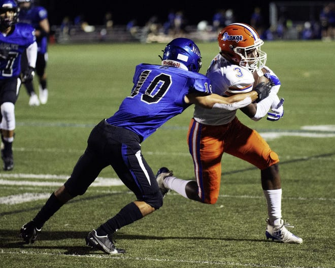 Hilliard Bradley's Mason Koons tries to tackle Olentangy Orange's Andre Robinson during the teams' game Sept. 25 at Bradley. The Pioneers won 37-34.