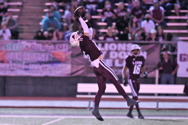 Brownwood's Dane Johnson (15) goes up to try and make a catch during Friday's game against Wylie at Gordon Wood Stadium in Brownwood on Sept. 25, 2020. The Bulldogs won 28-7 to open their year while the Lions fell to 2-3.
