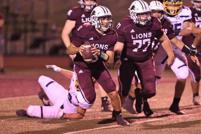 Brownwood quarterback Chance Jones (9) looks downfield for a receiver during Friday's game against Wylie at Gordon Wood Stadium in Brownwood on Sept. 25, 2020. The Bulldogs won 28-7 to open their year while the Lions fell to 2-3.