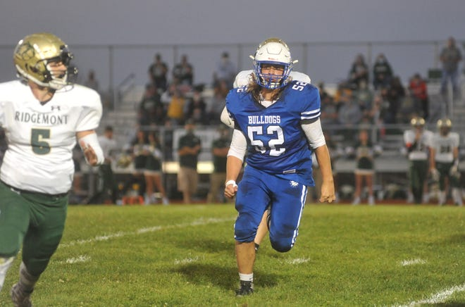 Crestline's Ethan Clark chases down the Ridgemont quarterback, he tormented the Gophers offense throughout the game.