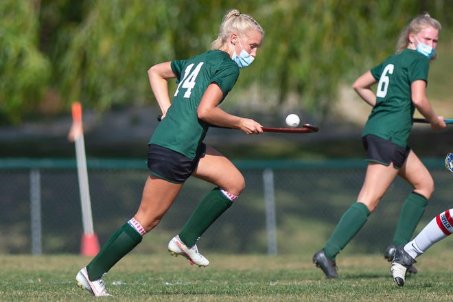 Rice's Belle Brown (14) air dribbles th eball down the field against Champlain Valley during a high school field hockey game in Hinesburg on Saturday, Sept. 26, 2020.