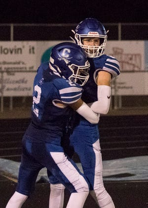 Chillicothe's Jaiden Cain hugs Logan Snowden after Snowden's touchdown against Miami Trace on Sept. 25, 2020 in Chillicothe, Ohio. Chillicothe defeated Miami Trace 44-3.
